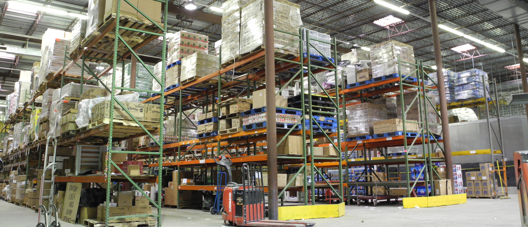 Panoramic view of the inside of Century Distributors' warehouse
